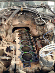 The cylinder head gasket, each passage marries up to the passages within the engine block and cylinder head.