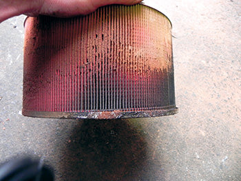 Air filter, caked with bulldust.
