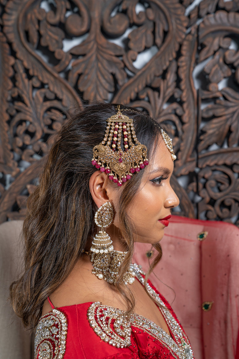 Regal Traditional Style gold jhoomar with Magenta Beads