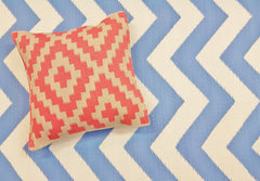 Cushions and chevron blue rug
