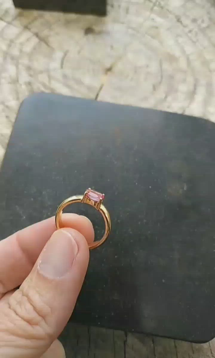 Pink topaz and gold engagement ring