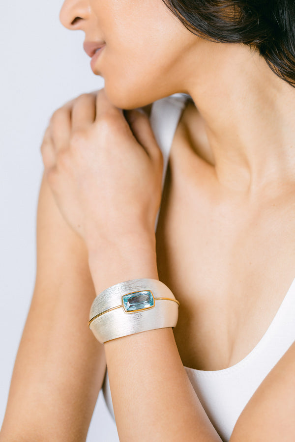 Brushed finish Argentium silver, blue topaz cuff with 18k vermeil accent