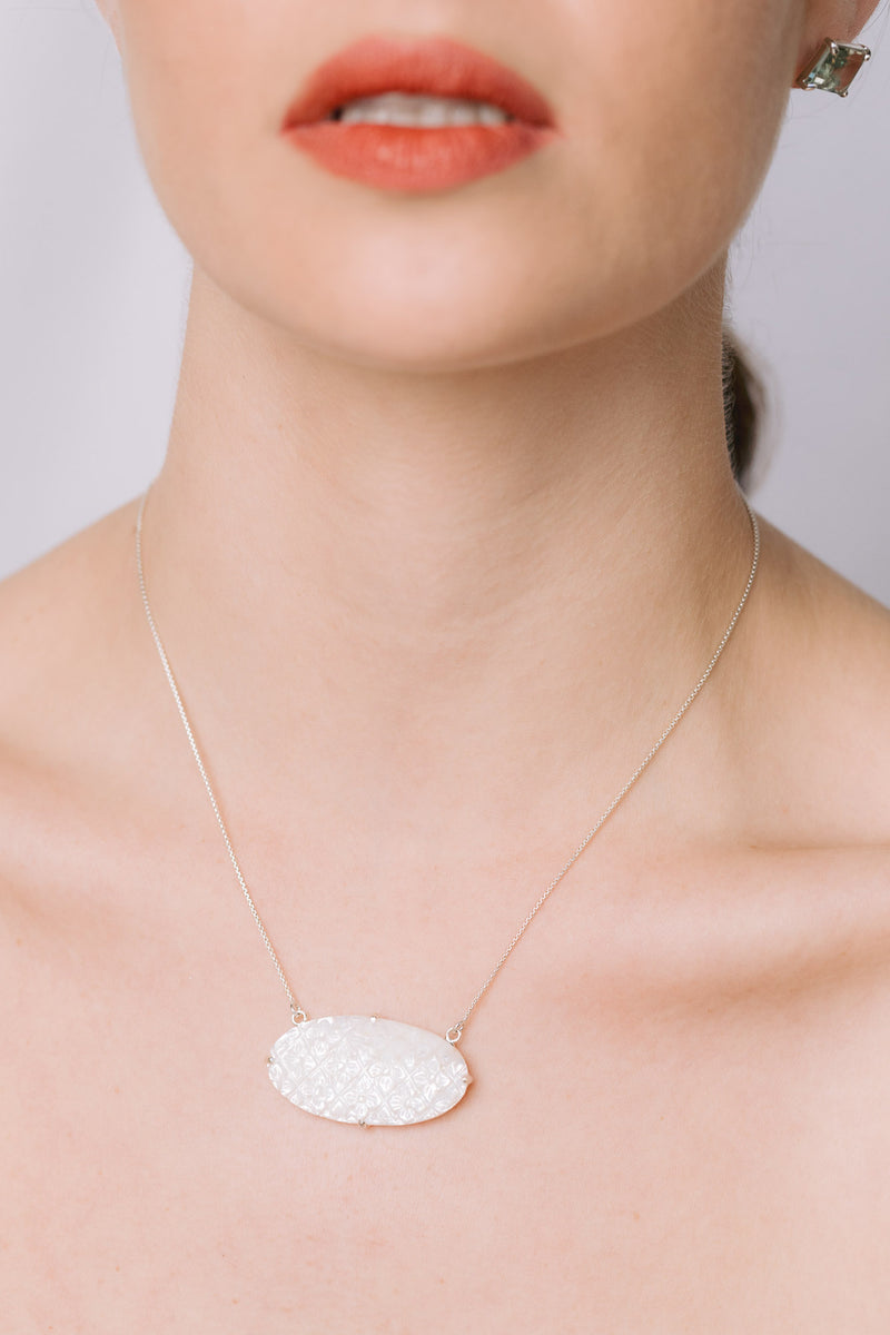 Carved mother of pearl necklace