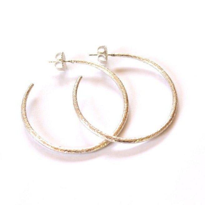 Large, textured sterling silver hoop
