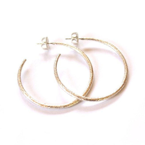 Small, textured sterling silver hoop