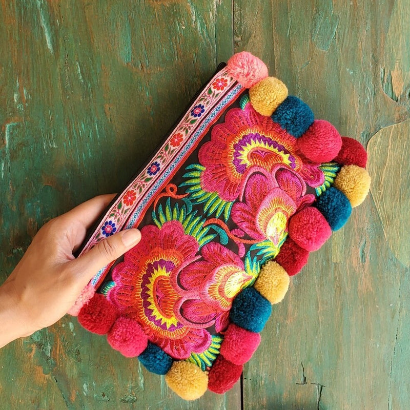 Multicolor, embroidered pom pom clutch