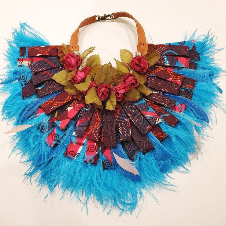 Blue feathered collar with African fabric, silk flowers and leather