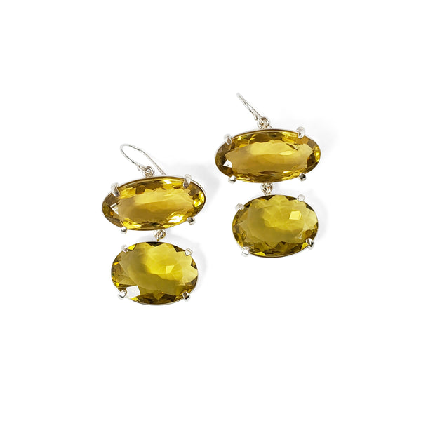 Oval cut lemon quartz prong set earring on earwire