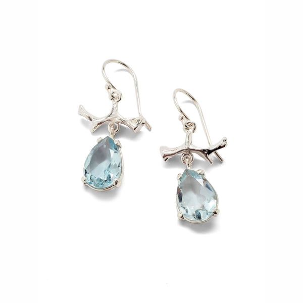 Blue topaz teardrop prong set earrings with sterling branch accent