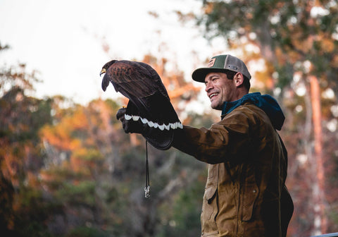 Edgar Diaz with Redtailed hawk