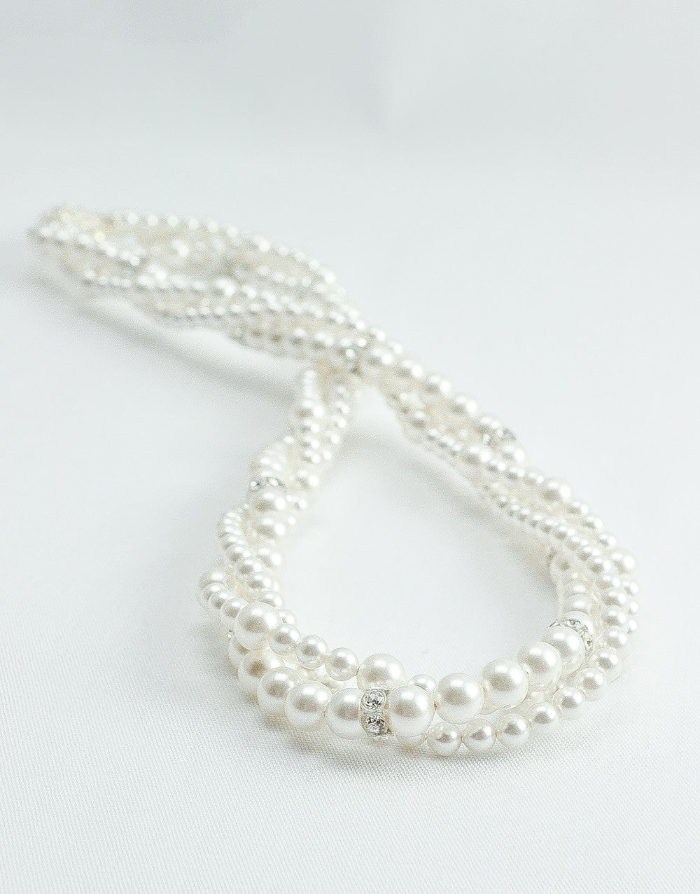 Multi Strand Pearl Necklace For A Sweetheart Neckline