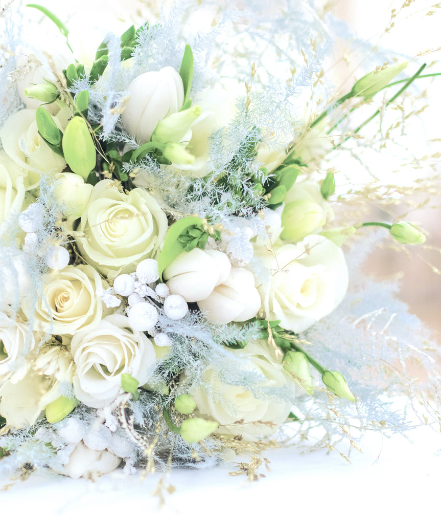 white bridal bouquet with dried flowers