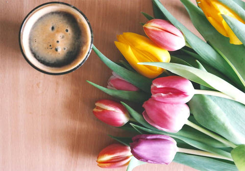 tulips and coffee on a table