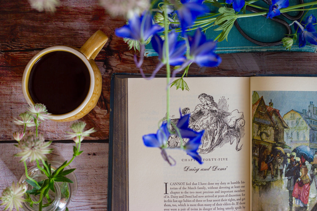 coffee book and flowers on a table