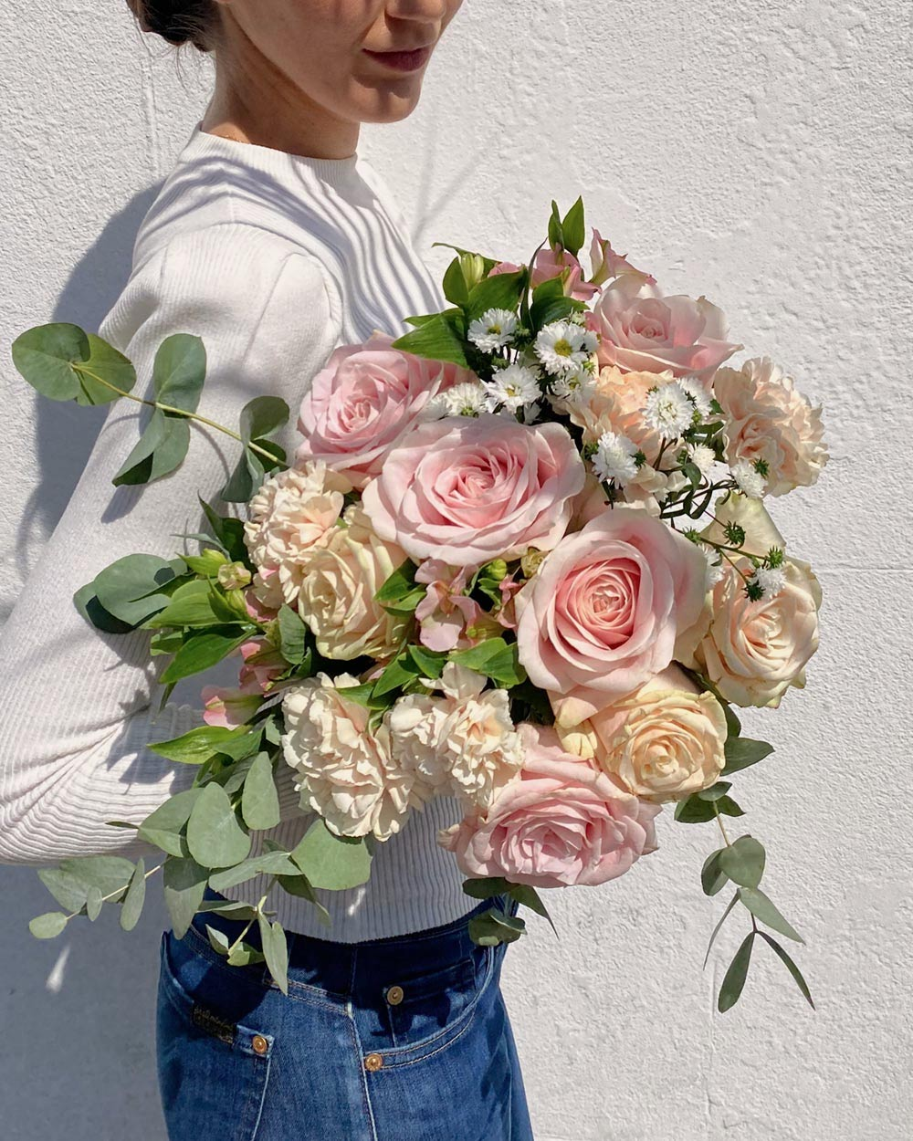 girl with pink bouquet of flowers - flower delivery uk