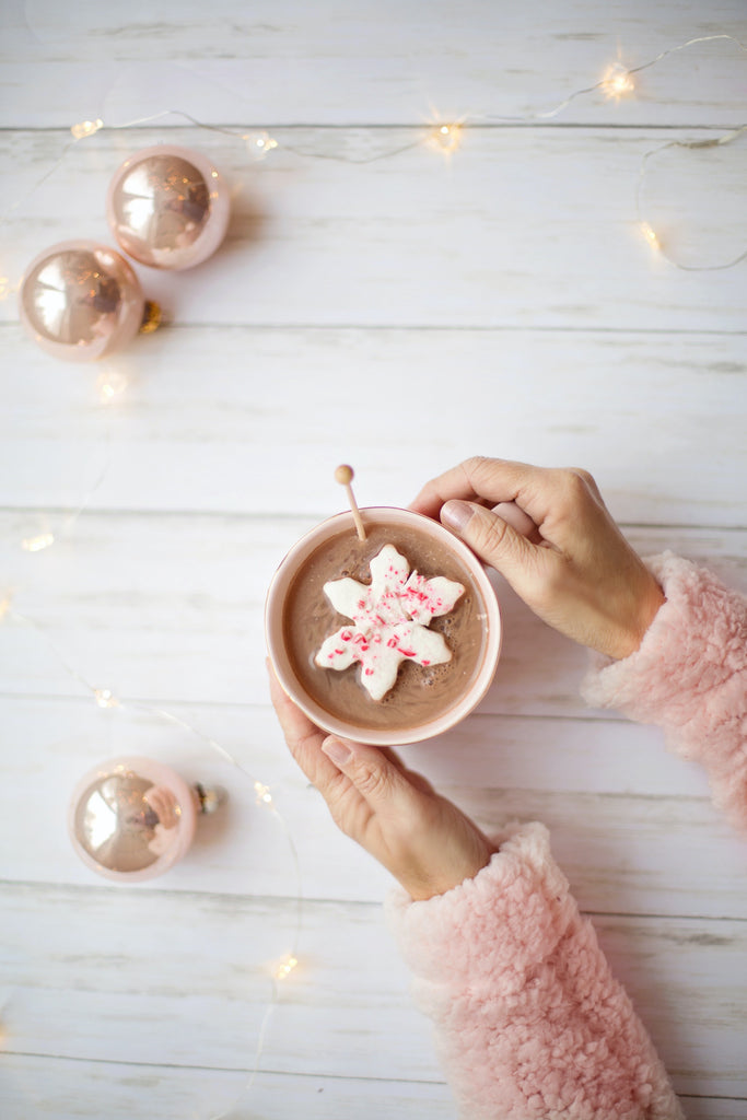 pink christmas sweater baubles hot cocolate