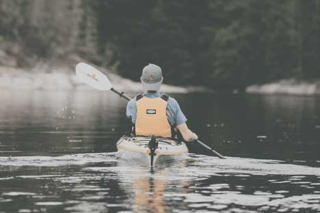 A person kayaking on a lake