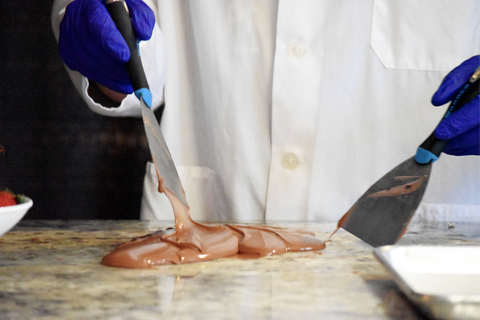 tempering chocolate with spades for chocolate covered strawberries