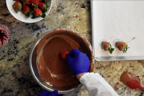 dipping strawberries into chocolate