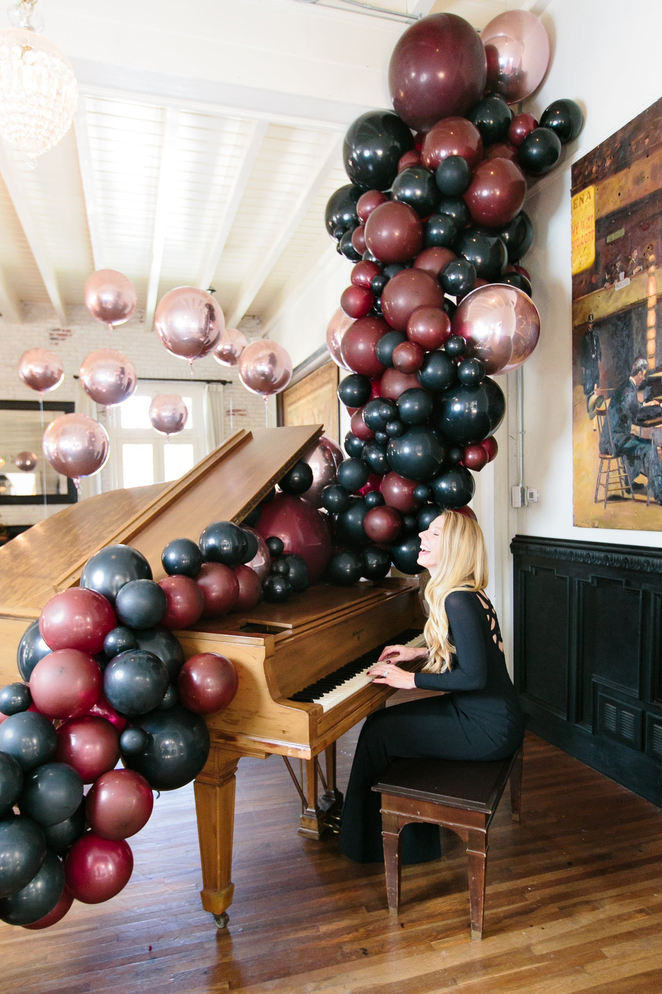 Balloon garland coming out of piano by Bonjour Fete