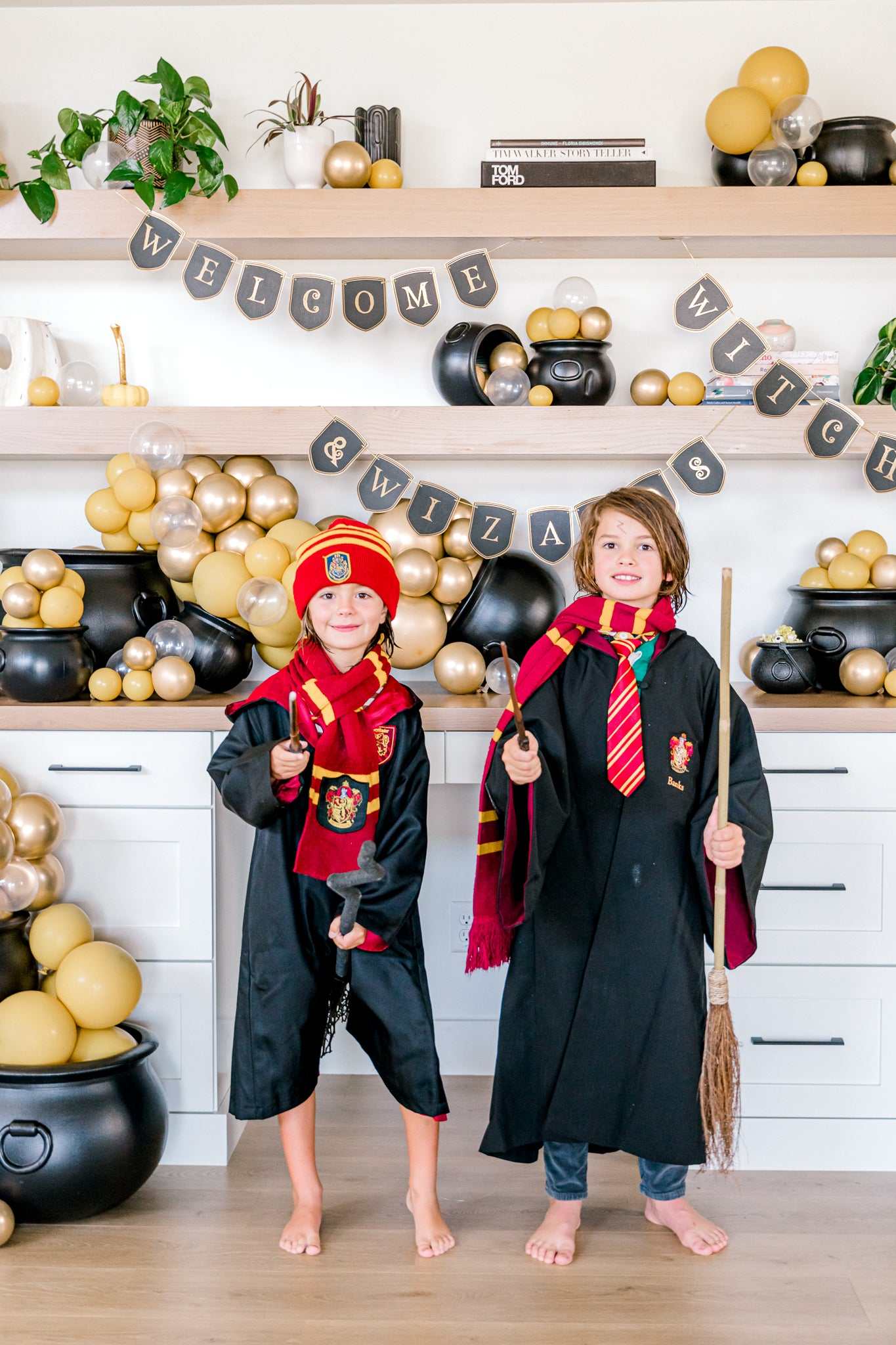 Boys dressed as Harry Potter characters at party