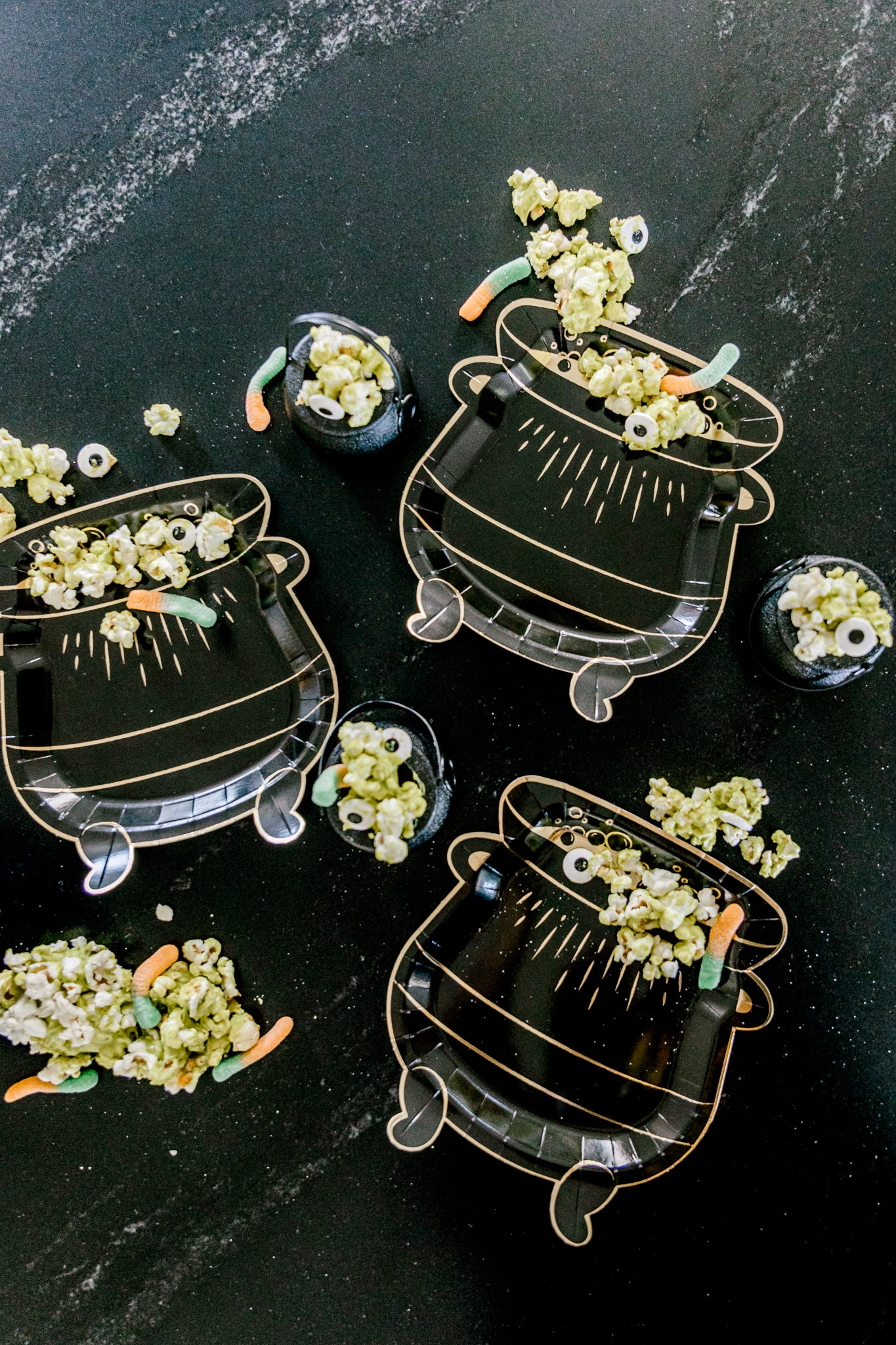 Cauldron plates with candy and popcorn