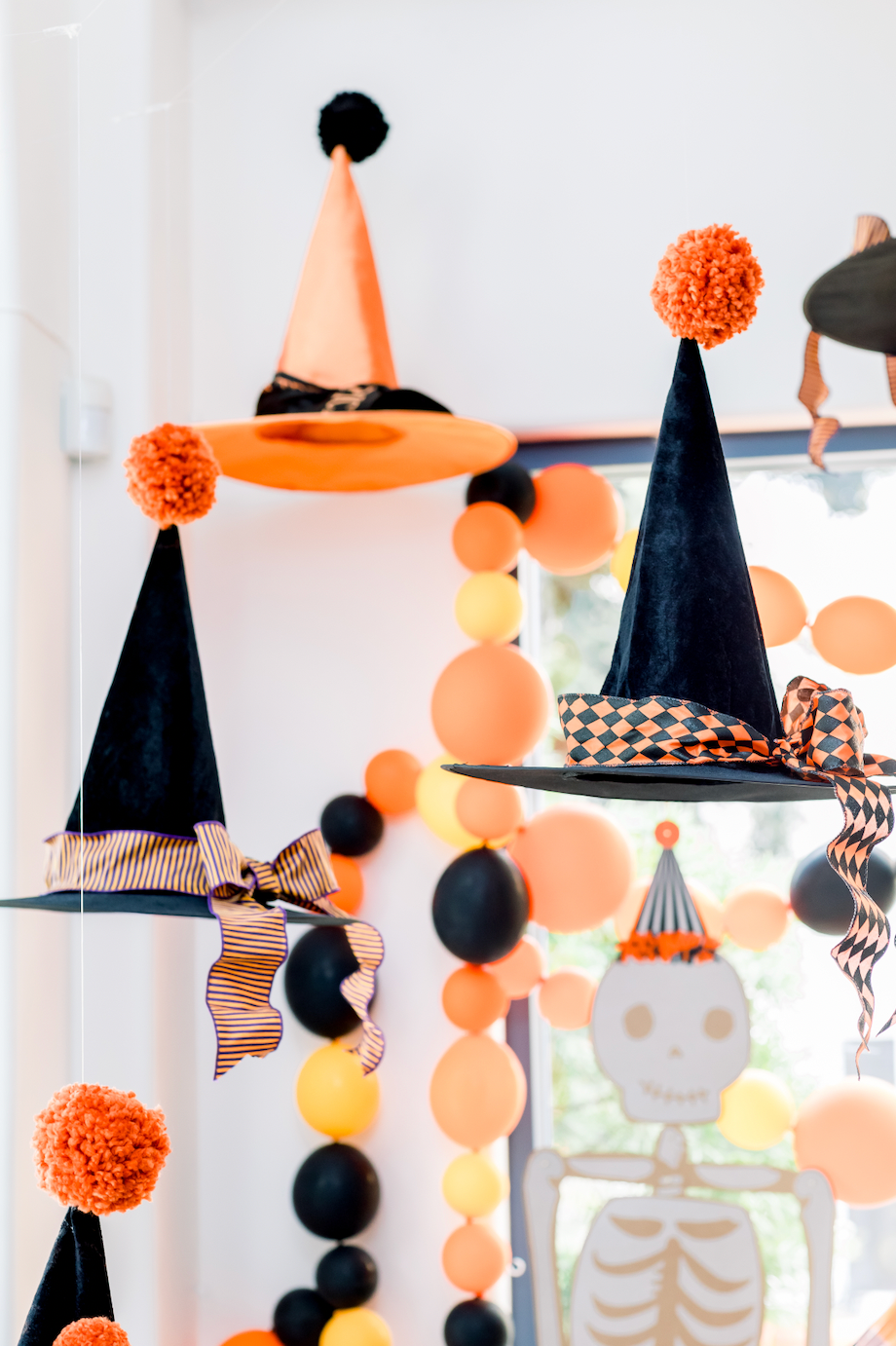 Vintage Halloween party hanging witch hats
