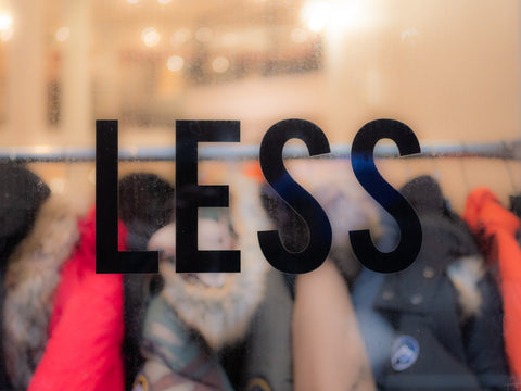 """""""Less"""" Sign on Clothing Store Window"""