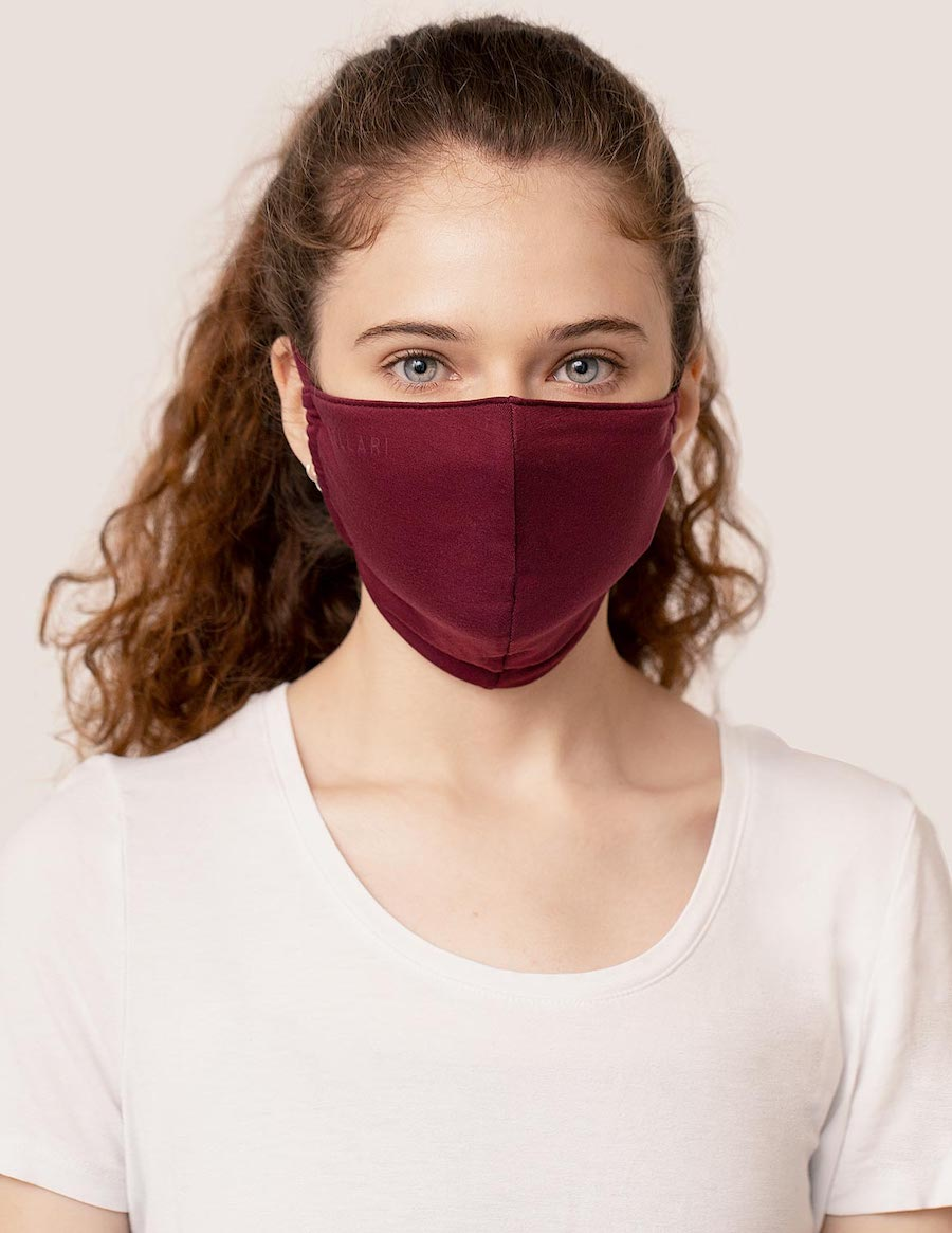 Model wearing garnet red sustainable cloth mask