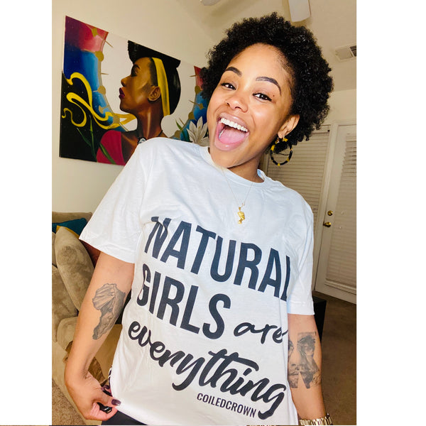 "smiling woman wearing t-shirt that says ""natural girls are everything"""