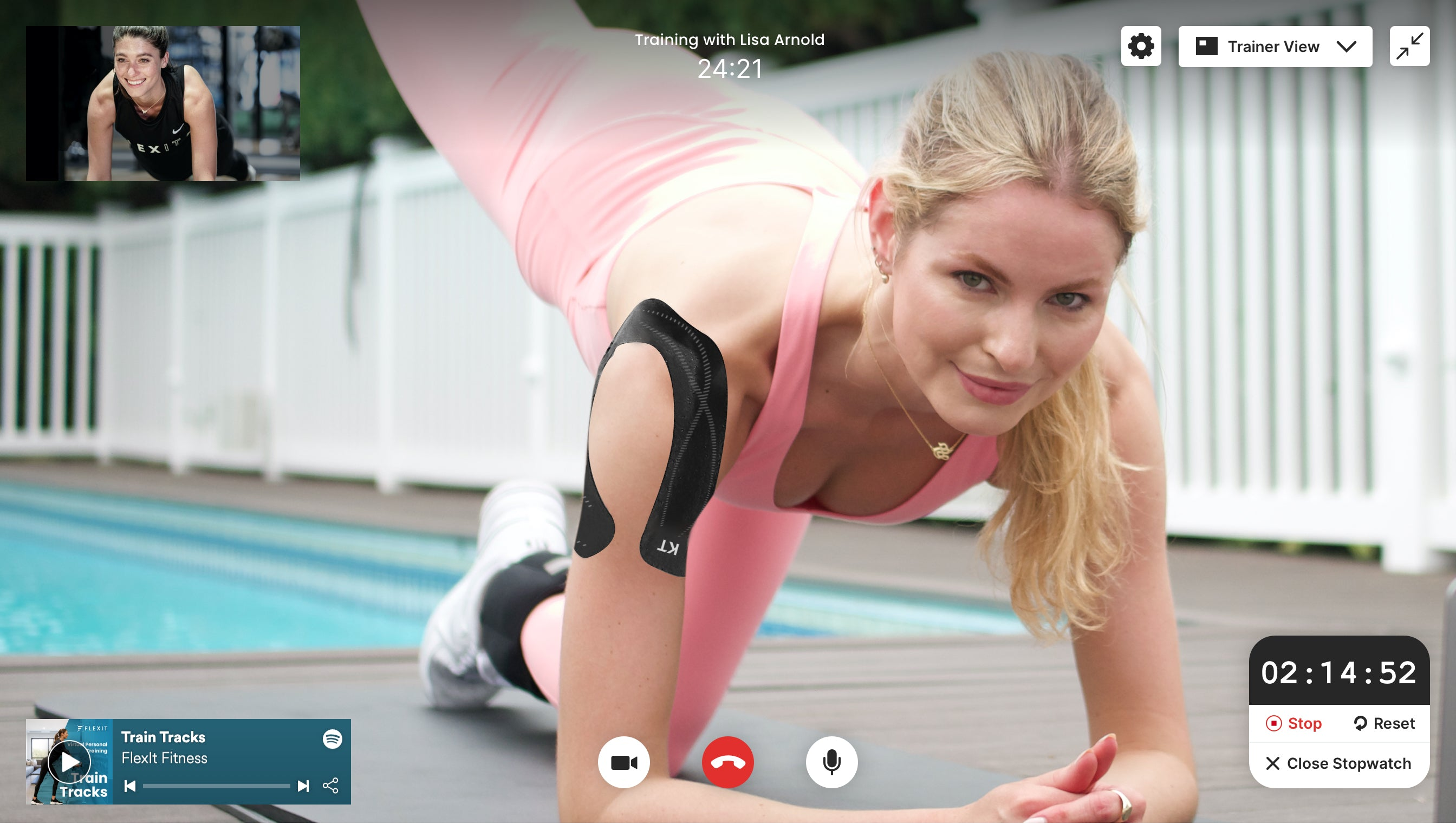 Woman working out by pool virtually with trainer