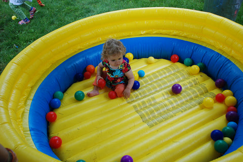 child playing in inflatable pool