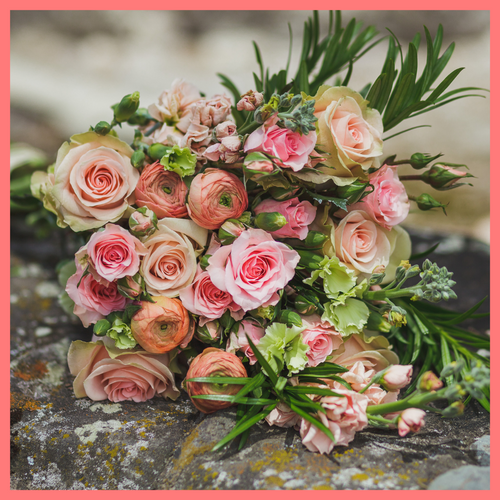 Order The Susie flower bouquet from our Mother's Day Collection.The Susie bouquet includes mixed stems of roses, coral ranunculus, stock, solomio, spray roses, and podocarpus greens. The flowers will be shipped directly from the farm to you!