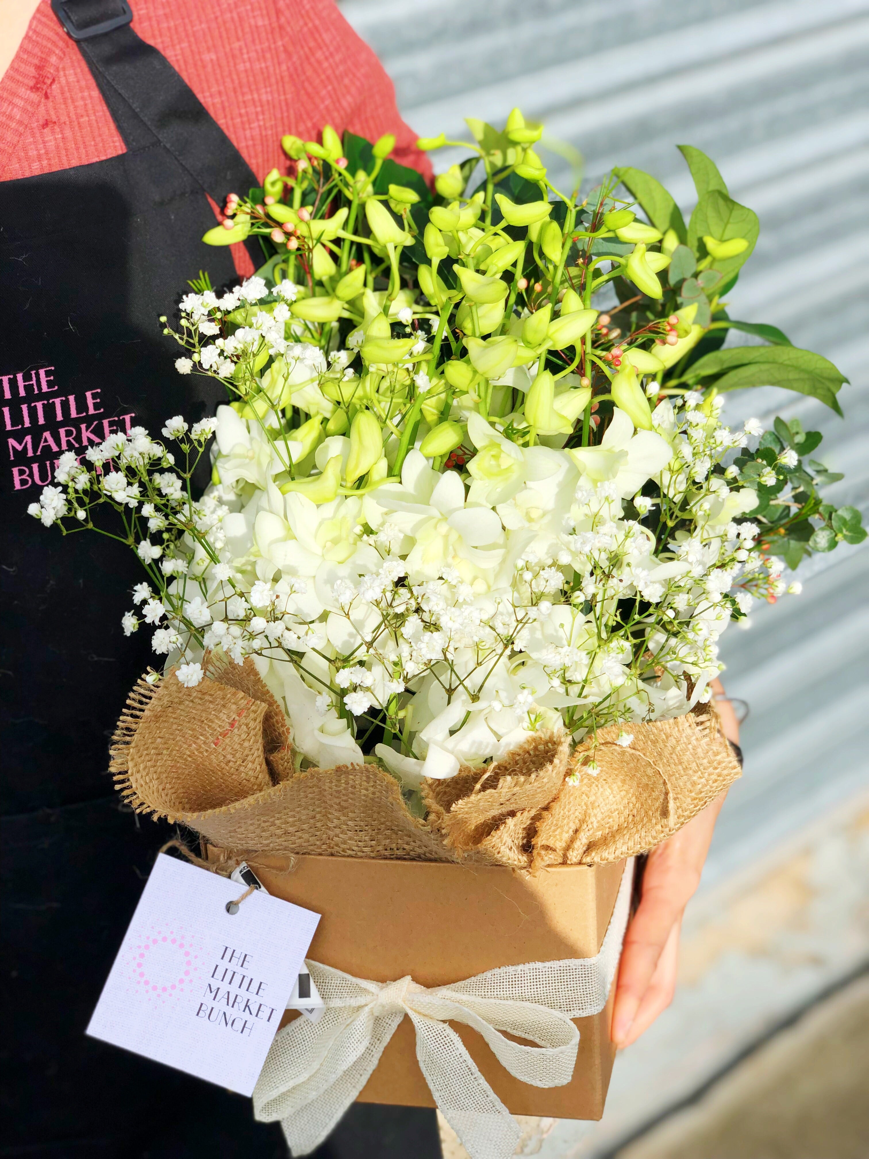 The little market bunch white funeral sympathy orchid box
