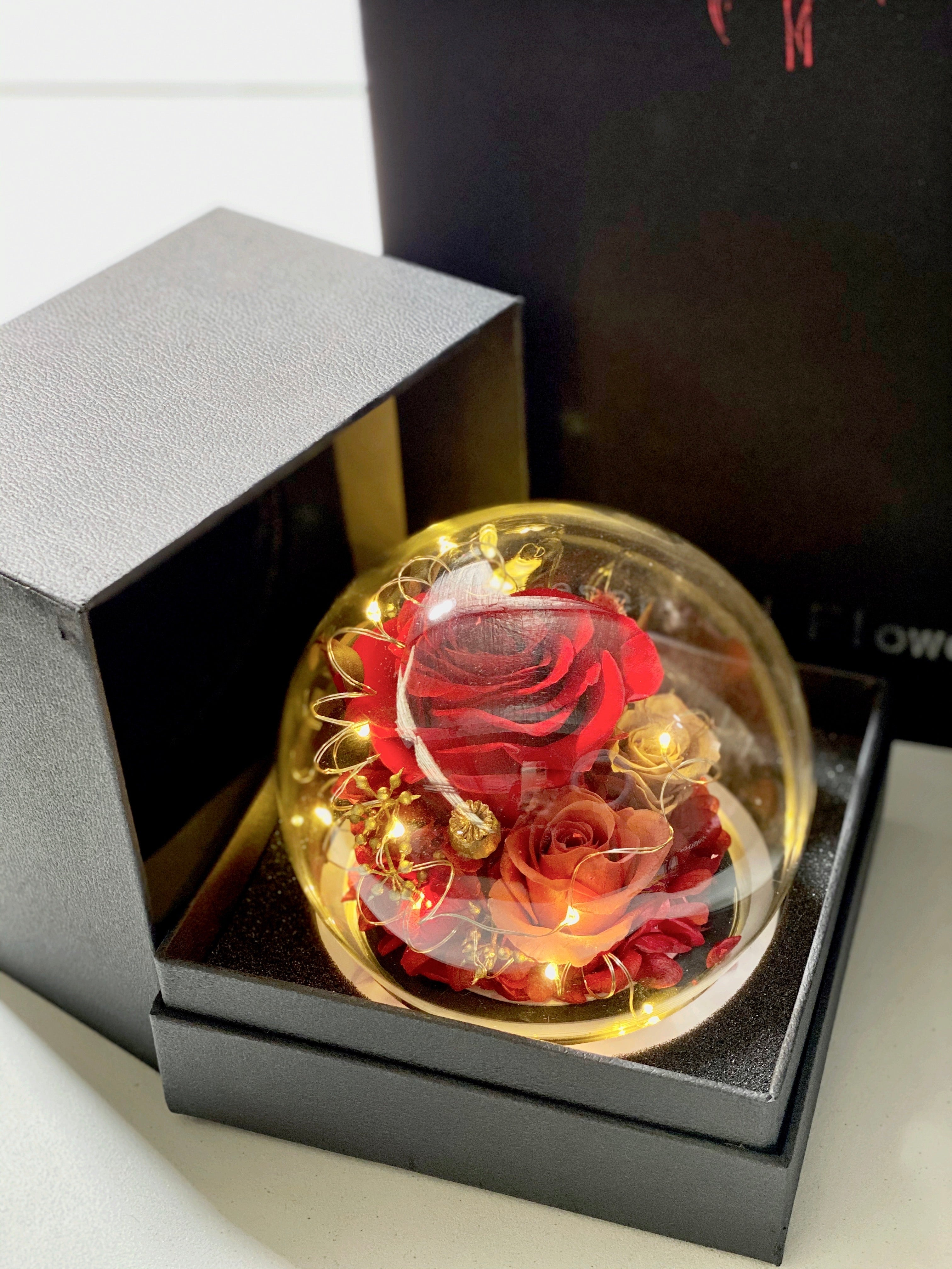 Preserved real rose in round bottle with LED light