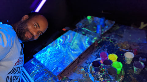 derrick with painting glow in the dark blacklight