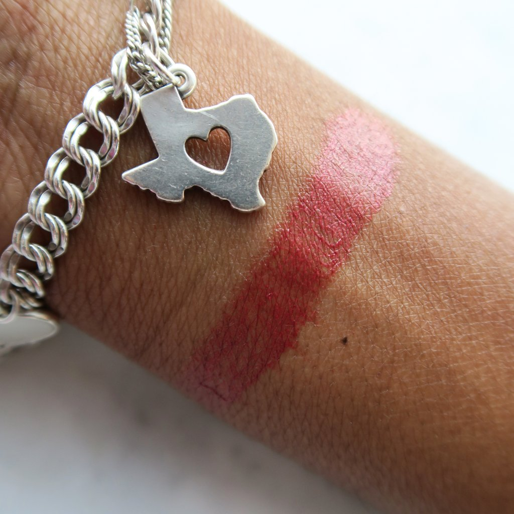 Image of a swatch of Houston Pretty Balm on model wrist