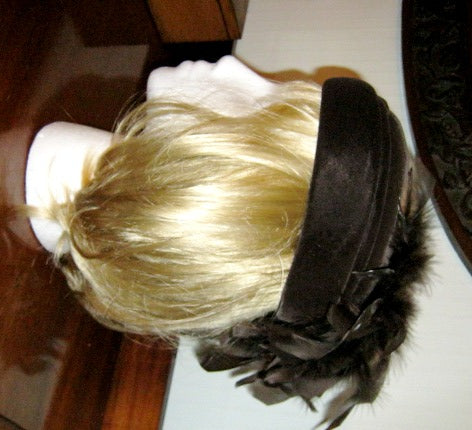 Brown velvet hat with feathers
