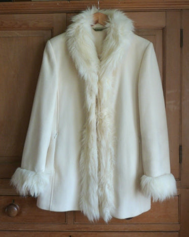 Winter white jacket with faux fur trim