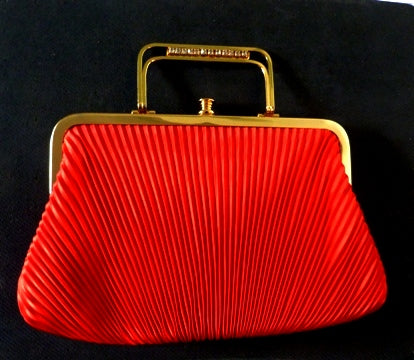 red pleated evening bag