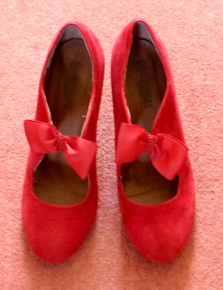 red velveteen shos with bows