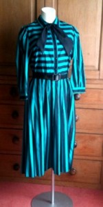 green and black striped 80s dress