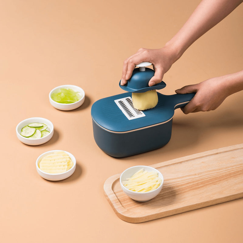 Kiru Kitchen Slicer being used to cut a potato