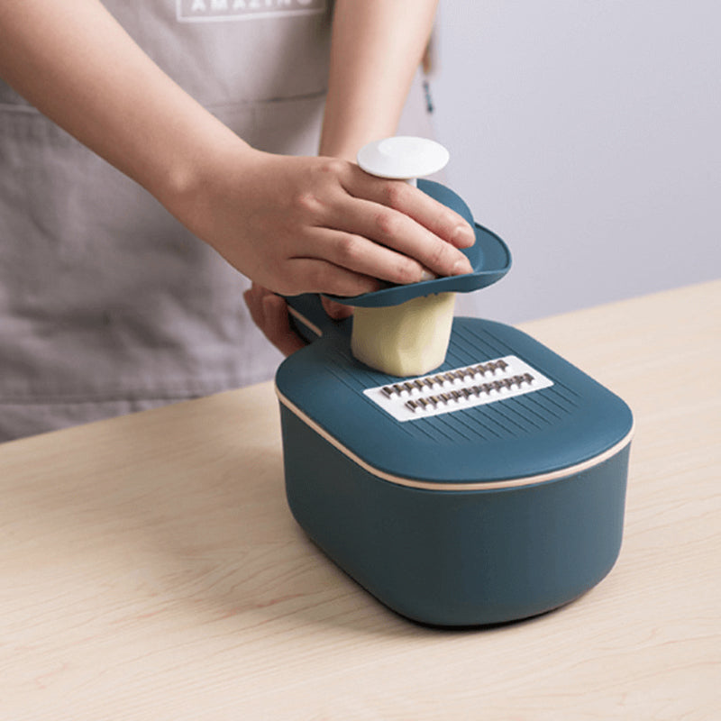 Kiru Kitchen Slicer being used to cut a potato close up
