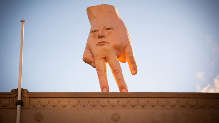 "GIANT FACE-HAND"" by Ronni Van Hout installed on roof in Wellington"