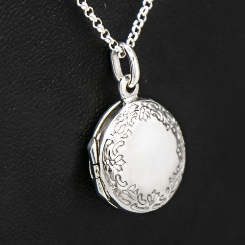 Close up view of round silver photo locket and silver chain