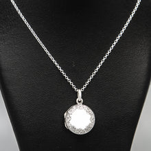 Load image into Gallery viewer, Front on view of round silver photo locket and silver chain