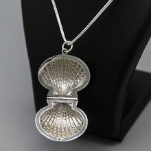 Load image into Gallery viewer, Silver Clam shell photo locket on thick silver italian chain displayed on black bust. Locket is open showing inside where photo would be placed.