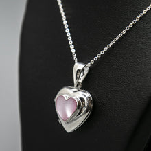 Load image into Gallery viewer, Silver heart shaped photo locket with pink mother of pearl inset with a silver Italian chain displayed on a black bust.