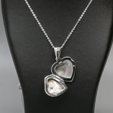 Load image into Gallery viewer, Silver heart shaped photo locket with pink mother of pearl inset with a silver Italian chain displayed on a black bust. Locket is open showing where photo is to be inserted.